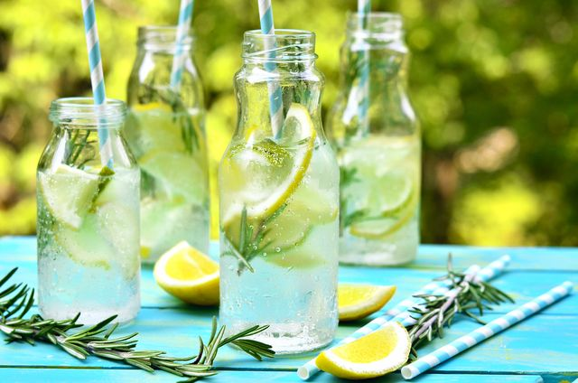 citrus fizz with rosemary in a bottle