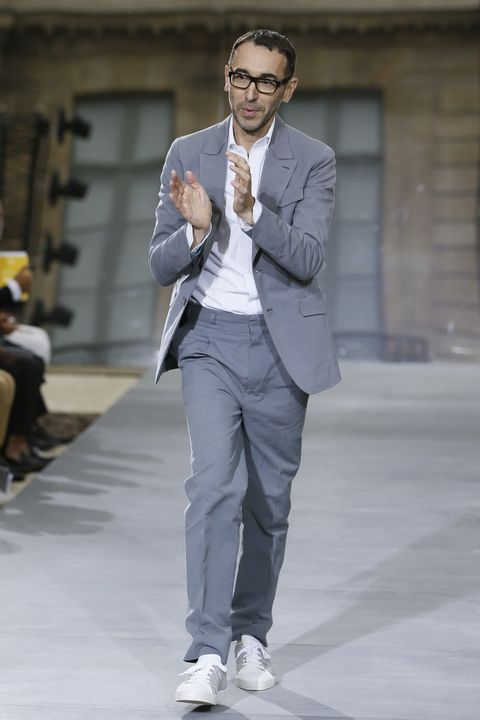 Fashion, Clothing, Street fashion, Suit, Fashion model, Blazer, Standing, Outerwear, Human, Fashion design,