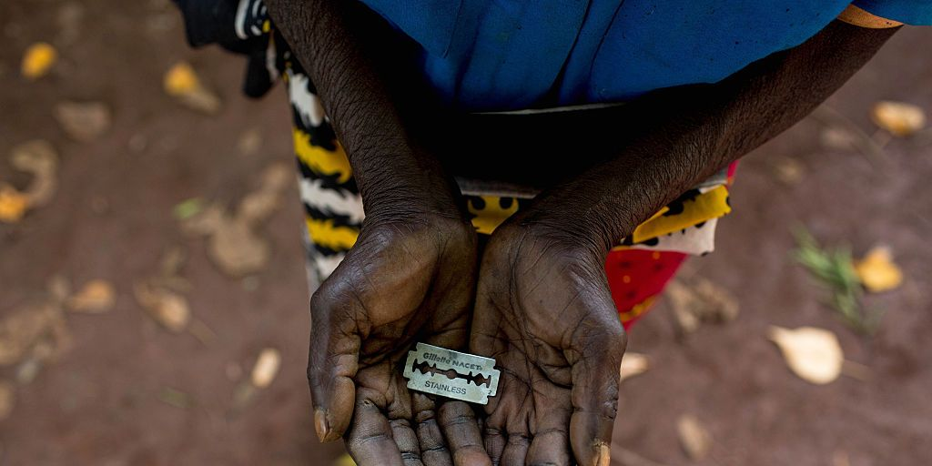 Cutter Anna-Moora Ndege shows the razorblade she uses to cut girls' genitals , on June 25, 2015, in Mombasa, Kenya. THESE are the rudimentary tools used to cut young girls sexual organs in remote villages in Kenya. The cruel practice of female genital mutilation (FGM) is illegal in the UK and in dozens of countries in Africa. But in remote Kenyan villages and communities far from the capital, Nairobi, the practice is very much alive and well.