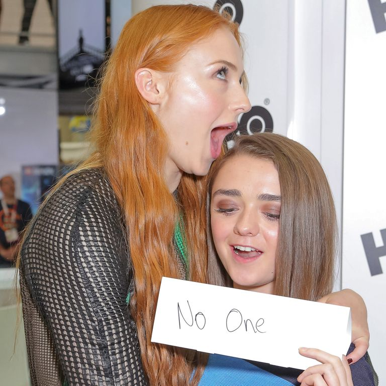 July 10, 2015 At Comic-Con in San Diego, Maisie shows off her nametag, which is a clever GoT reference, and Sophie attempts to...eat her friend's hair? I dunno.