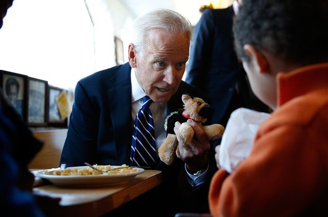 washington, dc   march 26  us vice president joe biden gives a young boy a stuffed version of bidens dog, champ, while visiting a diner march 26, 2014 in washington, dc biden visited the florida avenue grill to highlight the administrations efforts to raise the national minimum wage to 1010 an hour  photo by win mcnameegetty images