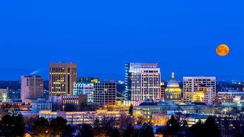 Blue night sky over Boise Idaho with moon