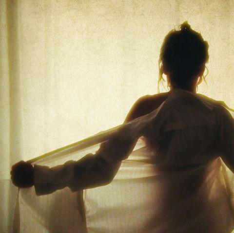 Sensual woman takes off blouse
