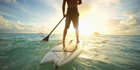 Stand up paddle surfing, Surface water sports, Wave, Surfing, Sky, Surfing Equipment, Water, Water sport, Recreation, Surfboard,