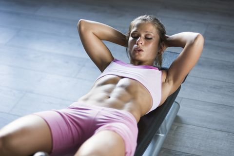 5 Mini-Band Abs Moves That Will Light Up Your Core Right in Your Living Room