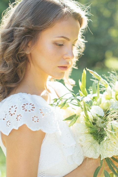 beautiful young girl holding a bouquet