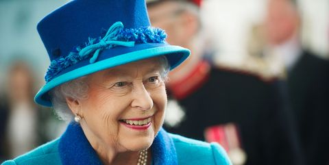 Facial expression, Blue, Turquoise, Smile, Fashion accessory, Headgear, Hat, Tradition, Electric blue, Happy,