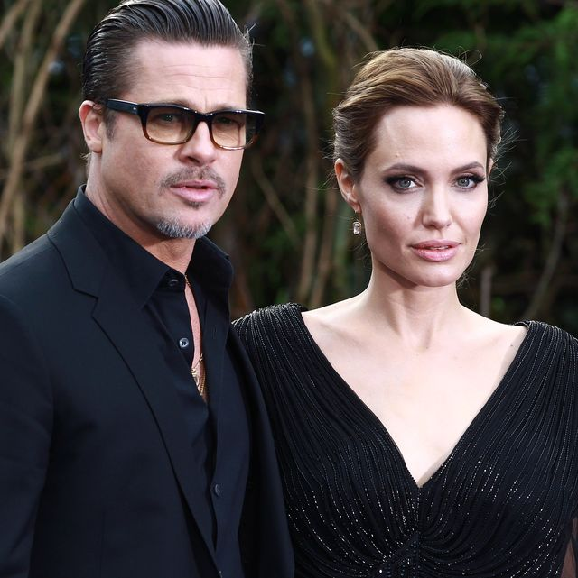 london, united kingdom   may 08 brad pitt and angelina jolie attend a private reception as costumes and props from disneys maleficent are exhibited in support of great ormond street hospital at kensington palace on may 8, 2014 in london, england photo by fred duvalfilmmagic