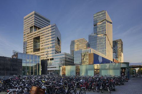 unverified content bicycle parking lot and modern business buildings, amsterdam zuidas district, amsterdam, the netherlands
