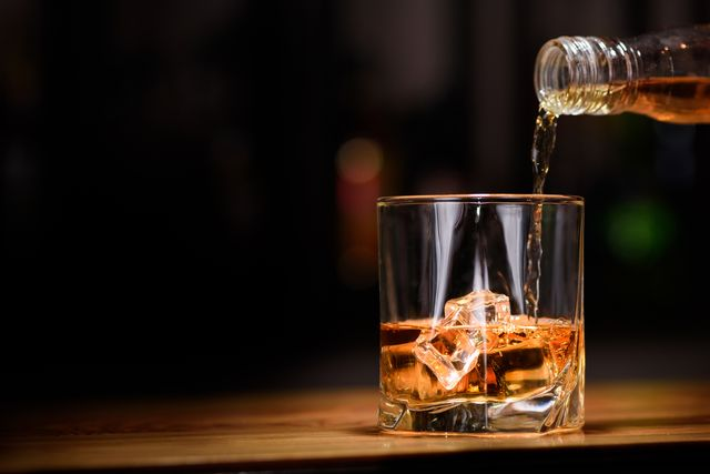 still life pour or whiskey in to glass