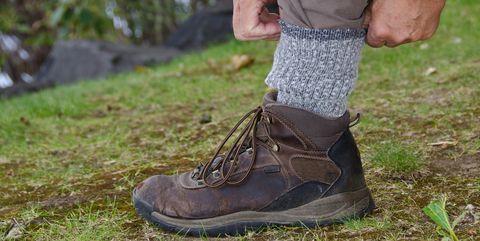 Footwear, Shoe, Boot, Brown, Hiking boot, Grass, Tree, Leg, Soil, Plant,