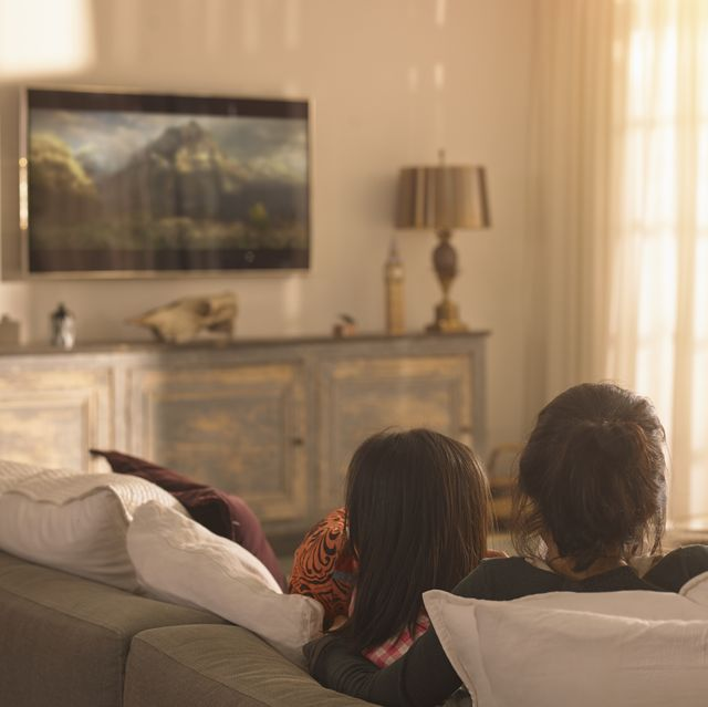 mother and daughter watching television streaming services, netflix, disney plus, amazon prime video