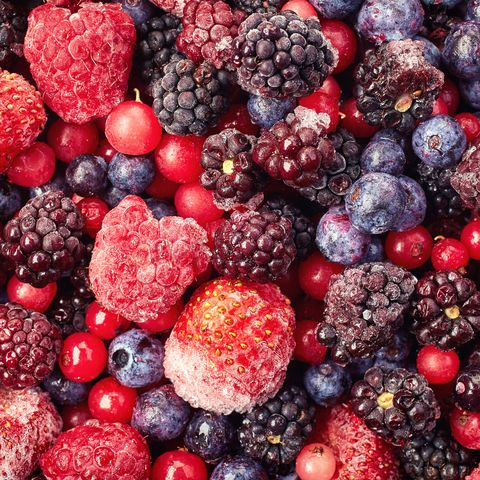 close up of frozen mixed fruit   berries   red currant, raspberry, strawberry, blackberry, blueberry