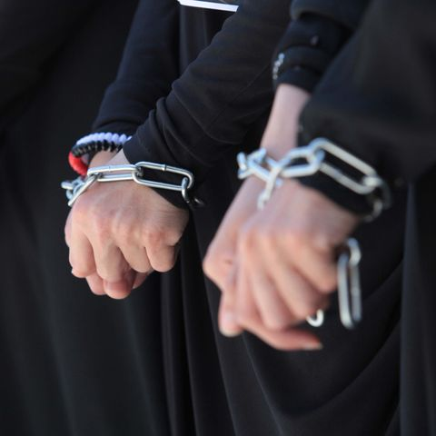 Hand, Street fashion, Fashion accessory, Law enforcement, Event, Photography, Finger, Suit, Formal wear, Gesture,