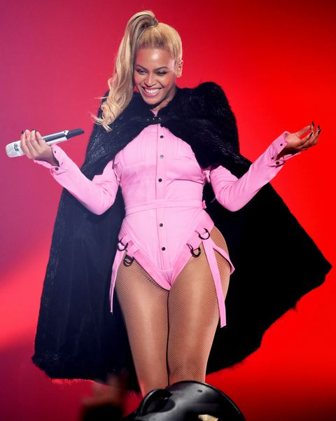 Blond, Performance, Pink, Singer, Leg, Thigh, Event, Latex clothing, Performing arts, Latex,