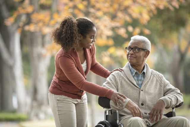 woman helping man in wheelchair