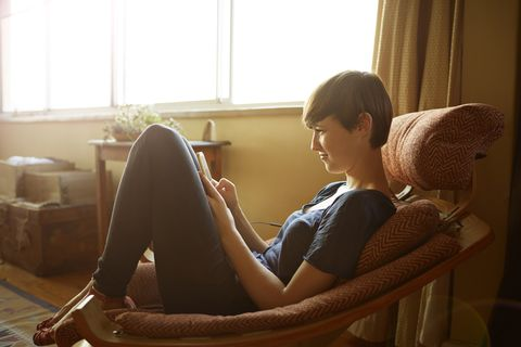 Sitting, Skin, Leg, Human, Room, Human leg, Sunlight, Footwear, Comfort, Furniture,