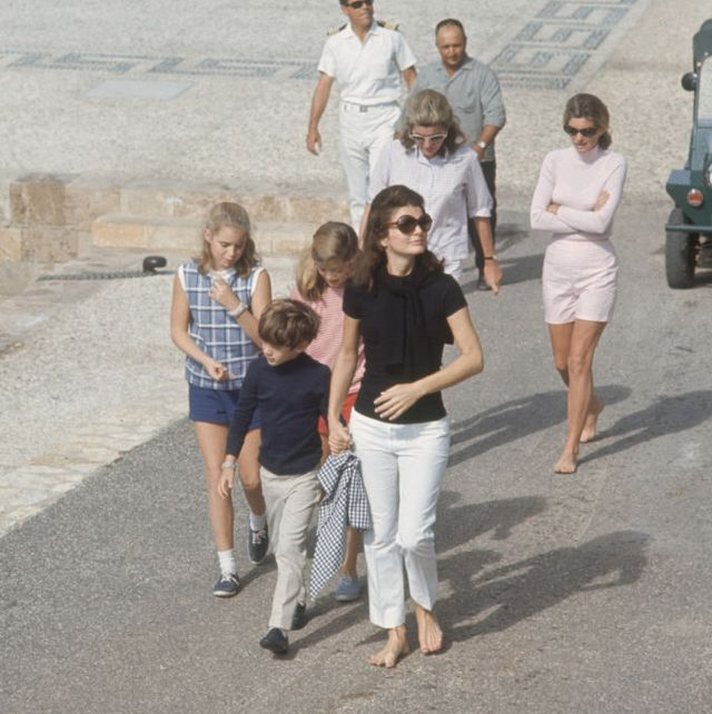 american editor and former first lady jacqueline kennedy onassis 1929   1994 front right, in dark shirt walks with her children, john jr 1960   1999 and caroline,, skorpios, greece, october 1968 among those behind them is kennedys sister lee radziwill and former sister in law pat lawford photo by bill ray the life picture collection via getty images