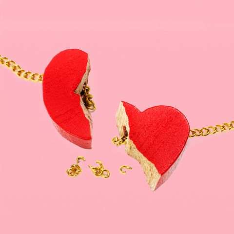 broken heart torn into 2 pieces and a broken gold chain