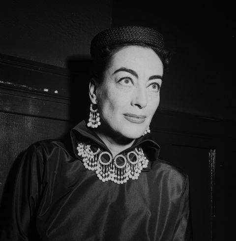los angeles   may 18, 1954 actress joan crawford attends to guest during the joan crawford fashion show in los angeles, california photo by earl leafmichael ochs archivesgetty images