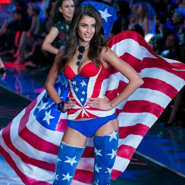 Fashion, Fashion show, Thigh, Flag of the united states, Event, Human leg, Model, Performance, Flag, Electric blue,
