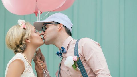 wedding, romantic couple kissing, in retro, vintage style, with balloons