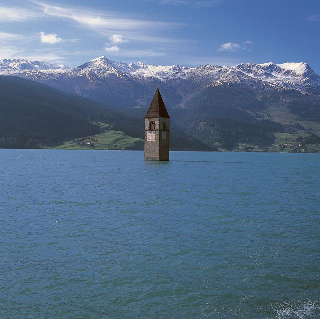italy   april 28 the old bell tower 14th century of curon venosta church rising out of the waters of the artificial lake of resia, trentino alto adige, italy photo by deagostinigetty images
