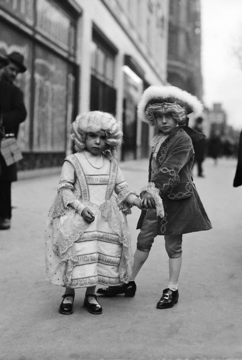 Two children wearing XVIIIth century costumes at the Mardi Gras festival in the streets of Paris