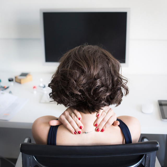 woman in pain at desk