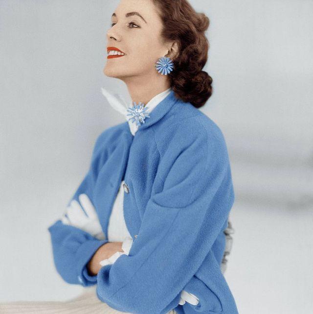 getty images model wearing brooch earrings