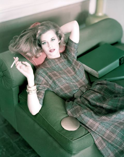 jane fonda with cigarette wearing plaid wool dress in brown and muted grey, cinched at the waist with brown suede belt photo by horst p horstconde nast via getty images