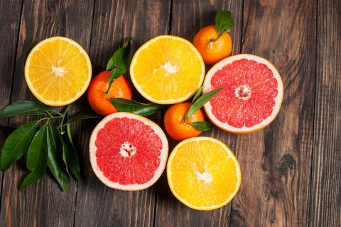 Citrus fruits. Over wooden table background