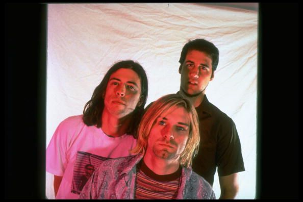 Kurt Cobain with fellow Nirvana bandmates Krist Novoselic and Dave Grohl in 1993.
