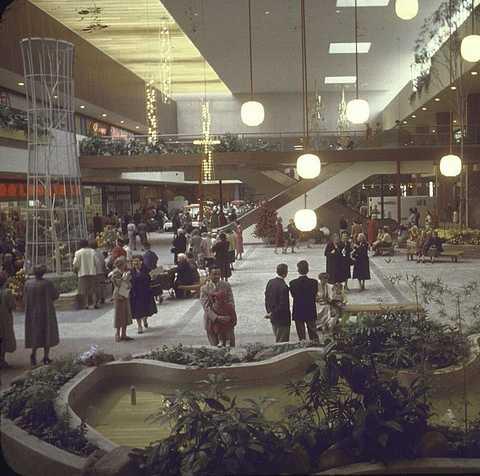 shoppers in interior garden court w vie