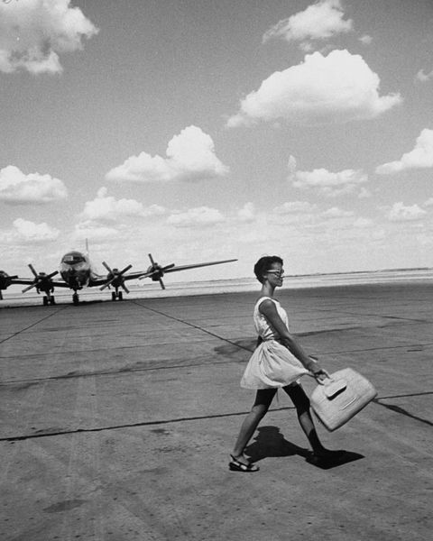 an american airline hostess crossing field on way to jobs as a model and sales clerk at neiman marcus  photo by lisa larsenthe life picture collection via getty images