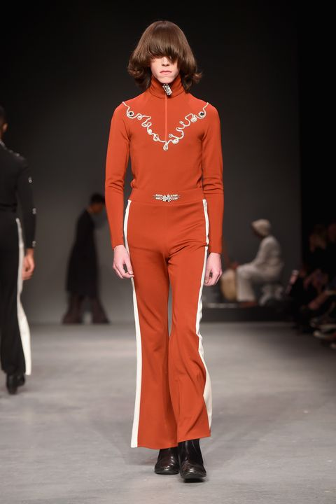 Fashion show, Fashion model, Fashion, Runway, Clothing, Orange, Event, Public event, Neck, Shoulder,