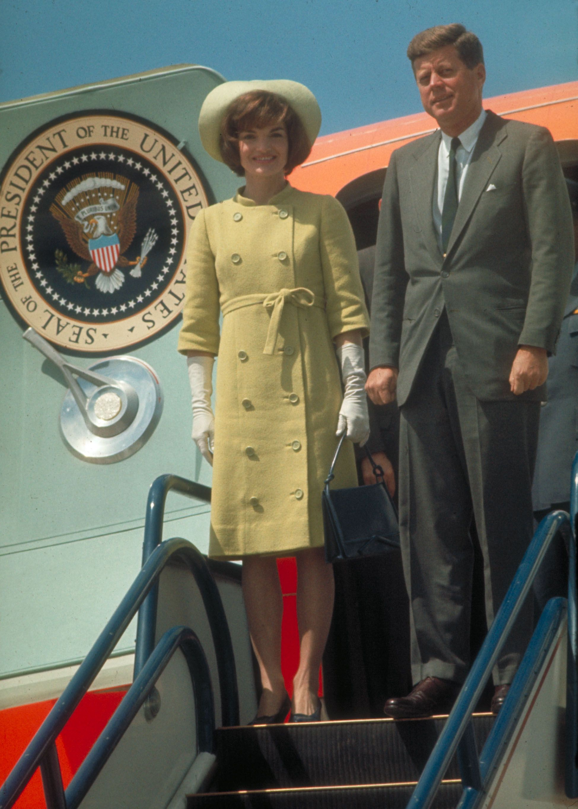 Jackie and JFK on Air Force One as they arrive in Latin America.