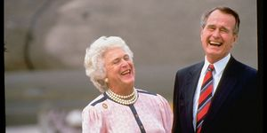george h w bush laughing with wife Barbara
