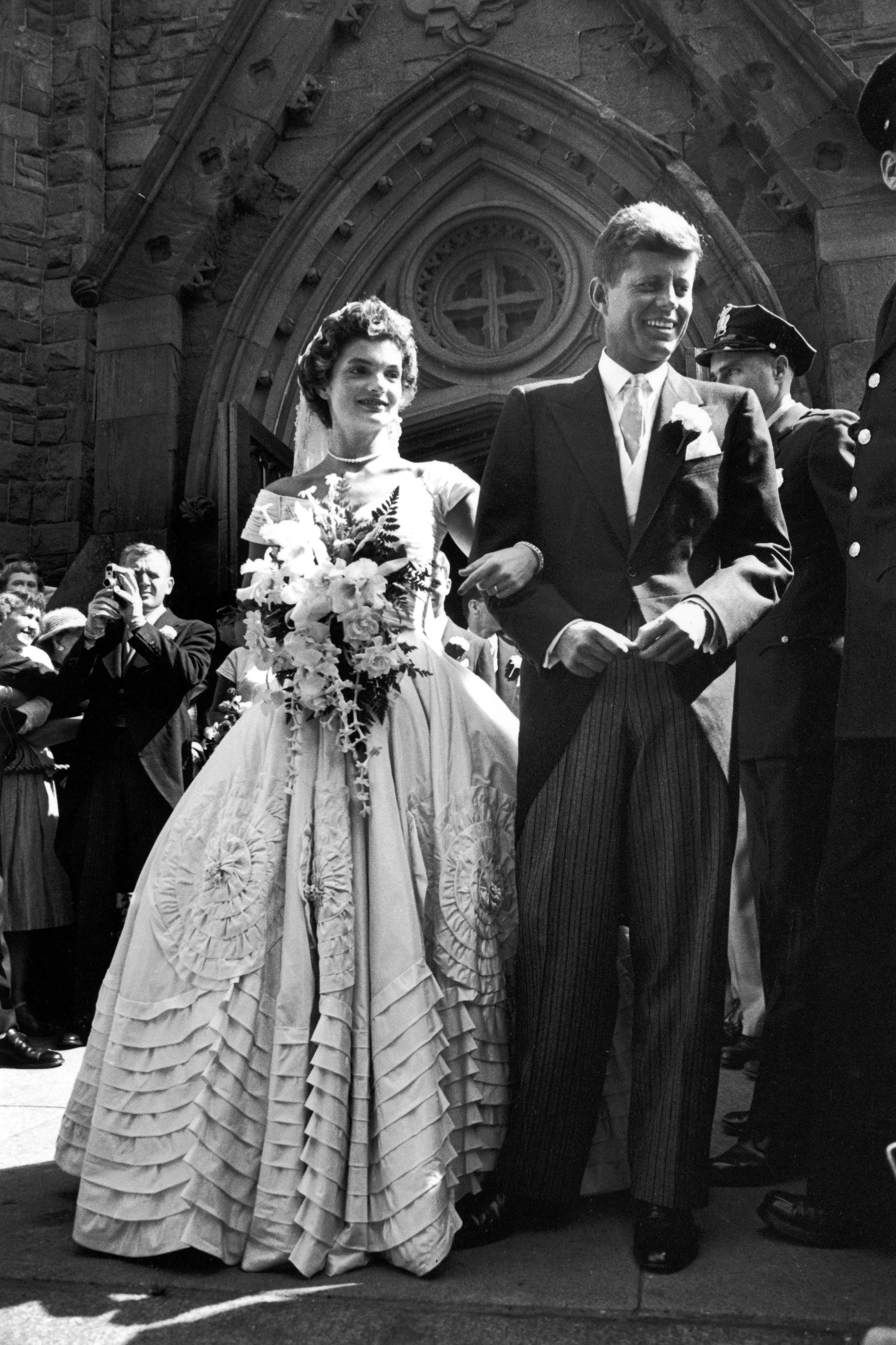 Jacqueline Bouvier's Wedding Dress Jacqueline Bouvier married John F. Kennedy on September 12, 1953 in Newport, Rhode Island. Her gorgeous wedding gown was created by African-American fashion designer Ann Lowe —who didn't receive credit for the dress until much later in life—and is now on display at the Kennedy Library in Boston.