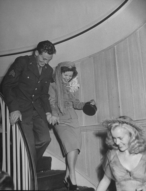 actress shirley temple c and bridegroom sgt john agar walking down steps after their wedding  photo by frank scherschelthe life picture collection via getty images