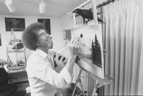 tv painting instructorartist bob ross painting one of his landscapes as his pet crow holds a paint brush in its beak while perched on <!-- WP QUADS Content Ad Plugin v. 2.0.25 --> <div class=