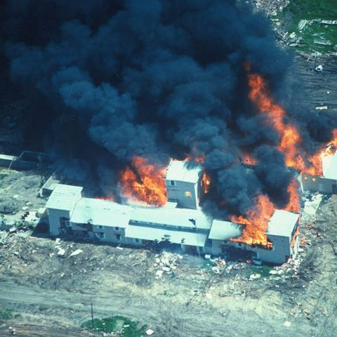 overhead of smoking fire consuming david koresh led branch davidian cult compound, believed set by cult after fbiatf teargassing in effort to end siege image used during congressional hrgs on handling of conflict   fbi claims it created enough holes inbldg to allow escape  photo by time life picturesfbithe life picture collection via getty images