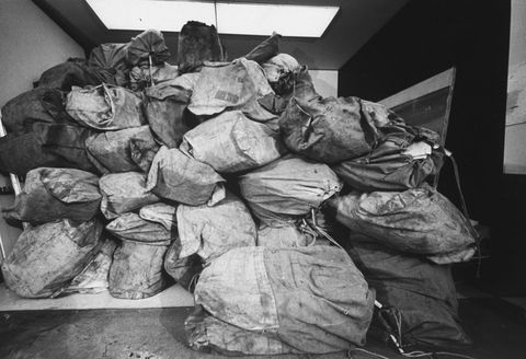 distant  close up views of mail bags containing enteries for the life photo contest mailbags stacked from floor to ceiling  bulging put of office door  photo by john olsonthe life picture collection via getty images