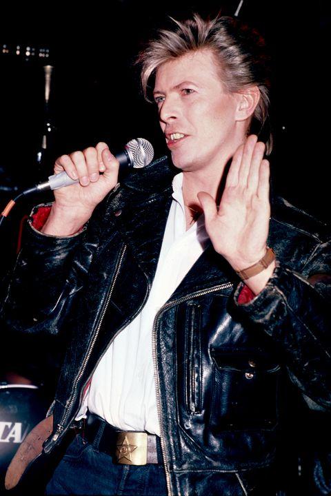 Performance, Singer, Pop music, Music artist, Leather, Jacket, Leather jacket, Singing, Musician, Music,