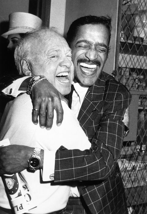 actor mickey rooney left hugging performer sammy davis jr backstage at rooneys broadway show, sugar babies, 6th april 1981  photo by david mcgoughdmithe life picture collection via getty images