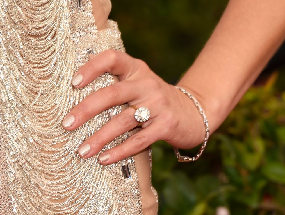 9 Ways to Wear Gold Nail Polish, the Power Suit of Manicures