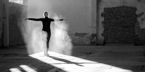 Modern ballerina dancing and training in abandoned building