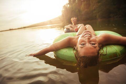 woman in lake on innertube