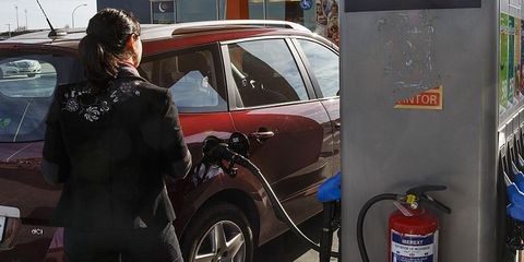 a customer uses a petrol pump to refuel a vehicle on the forecourt of a repsol sa gas station in madrid, spain, on friday, feb 5, 2016 oil prices will stay low for as long as 10 years as chinese economic growth slows and the us shale industry acts as a cap on any rally, according to the worlds largest independent oil trading house photographer angel navarretebloomberg via getty images