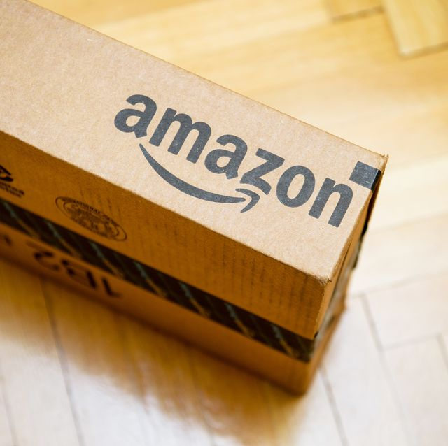 paris, france   january 28, 2016 amazon logotype printed on cardboard box side seen from above on a wooden parwuet floor amazon is an american electronic e commerce company distribution worlwide e commerce goods
